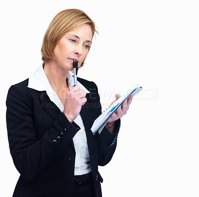 Buy stock photo Portrait of pretty mature female thinking while writing on notepad isolated over white background
