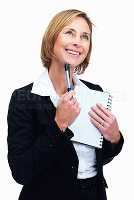 Buy stock photo Portrait of happy mature female lawyer holding writing pad and pen while looking up at copyspace