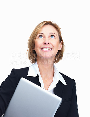 Buy stock photo Portrait of happy mature businesswoman with laptop in hand while looking upwards – Copyspace