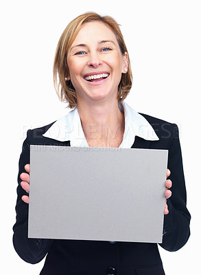 Buy stock photo Closeup portrait of cheerful mature businesswoman holding blank billboard isolated over white background