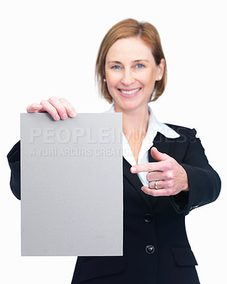 Buy stock photo Portrait of happy middle aged businesswoman pointing at a blank billboard isolated over white background