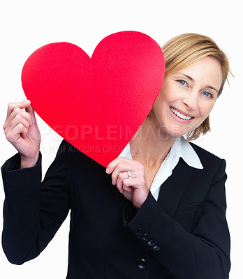 Buy stock photo Mature pretty woman holding heart on white background