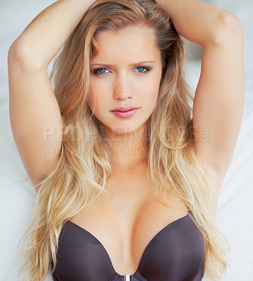 Buy stock photo Portrait of a pretty young woman posing in a brassiere