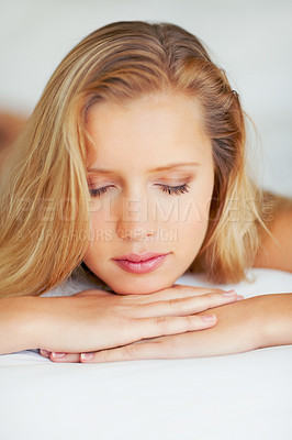 Buy stock photo Closeup of an attractive woman relaxing with eyes closed
