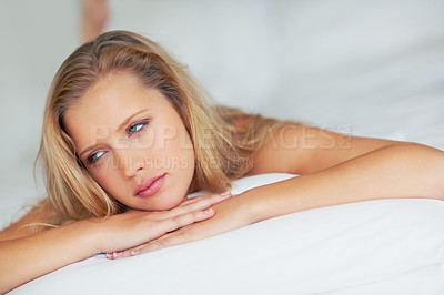 Buy stock photo Portrait of a thoughtful attractive young woman on bed