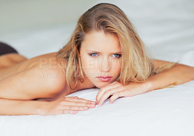 Buy stock photo Portrait of a young hot semi naked woman lying alone on bed