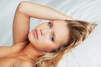 Buy stock photo Portrait of a seductive woman lying on bed