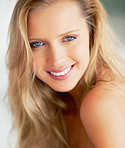 Closeup of an attractive blond smiling at you