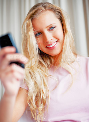 Buy stock photo Happy cute young woman holding a mobile phone