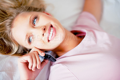 Buy stock photo Top view of a relaxed smiling Caucasian woman using a cellphone