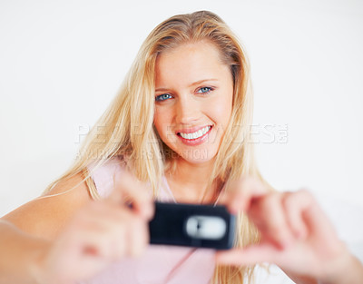 Buy stock photo Self photography - Portrait of a Caucasian woman with a cell phone isolated on white background