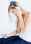 Side view of a female listening to music on headphones