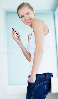 Buy stock photo Portrait of a cute and casual woman using a cellphone