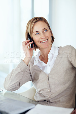 Buy stock photo Portrait of happy middle aged businesswoman talking on mobile while at office