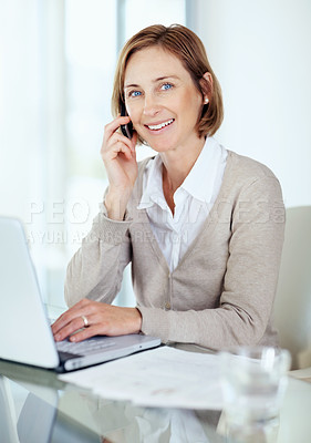 Buy stock photo Portrait of happy mature businesswoman talking on mobile looking away
