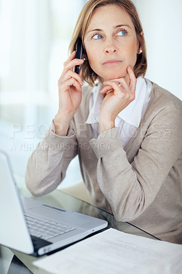 Buy stock photo Portrait of mature businesswoman talking on mobile looking away while thinking