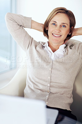 Buy stock photo Portrait of middle aged businesswoman relaxing at her desk