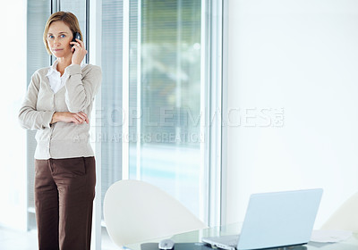Buy stock photo Portrait of a confident lady having a conversation over mobile at office