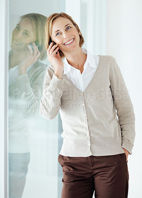 Buy stock photo Portrait of a happy mature woman talking on mobile phone