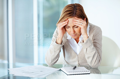 Buy stock photo Portrait of tensed  business woman holding her head while at work