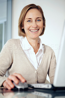 Buy stock photo Portrait of mature businesswoman working on laptop at her desk