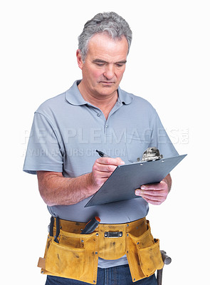 Buy stock photo Mature handyman making notes on a notepad isolated against white background