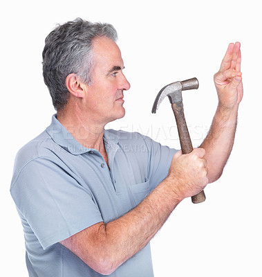 Buy stock photo A mature man hammers a nail to an invisible wall isolated on white background