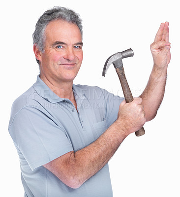 Buy stock photo Happy mature man ready to hammer a nail into a wall against white background
