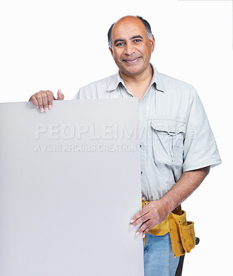 Buy stock photo Portrait of a mature carpenter with a blank billboard on white