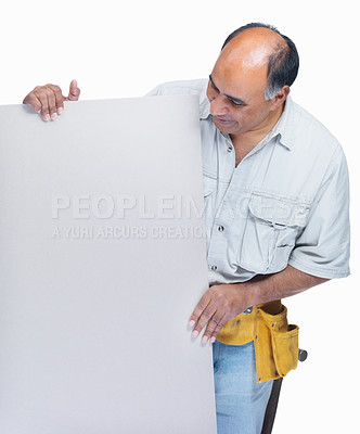 Buy stock photo Mature carpenter looking at your text on an empty billboard on white background