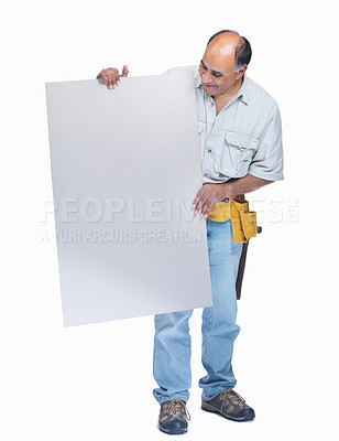 Buy stock photo Portrait of a happy mature handyman holding a blank billboard on white
