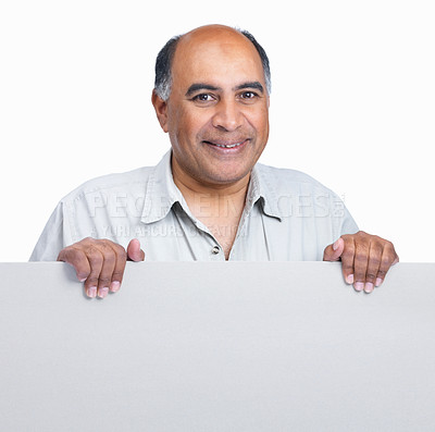 Buy stock photo Portrait of a smiling middle aged man holding a blank advertisement board on white