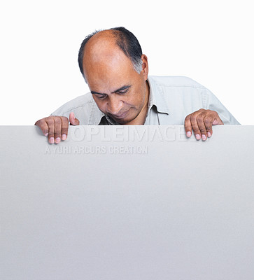 Buy stock photo Portrait of mature man holding a blank billboard isolated on white