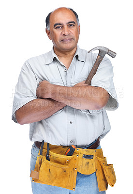 Buy stock photo Confident serious senior handyman wearing a tool belt with hammer in hand