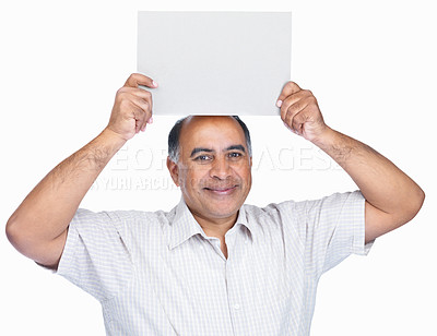 Buy stock photo Middle aged man holding a blank billboard over head against white