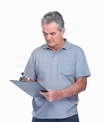 Buy stock photo Portrait of a senior man with a notepad on while making notes