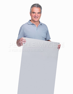 Buy stock photo Portrait of a happy senior guy holding a blank advertisement board isolated on white