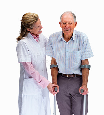 Buy stock photo Portrait of a nurse helping a man on crutches against white background