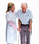 Nurse helping a senior man on crutches against white