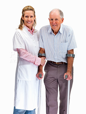 Buy stock photo Portrait of a beautiful nurse helping a patient on crutches against white