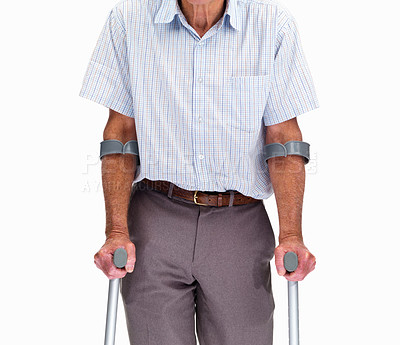 Buy stock photo Mid section of a senior man with crutches isolated against white background