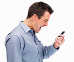 Side view of a mature man yelling into a cell phone on white