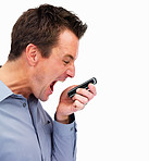 Mature man yelling into a cell phone isolated on white