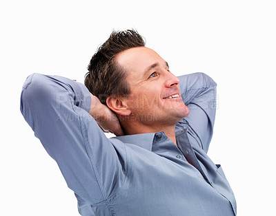 Buy stock photo Mature man with hands resting behind head looking at copyspace on white background