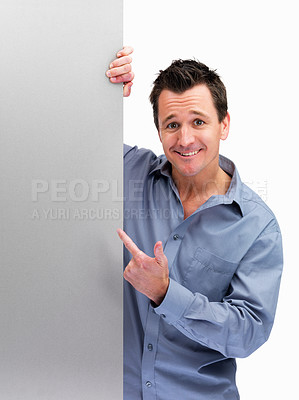 Buy stock photo Mature man pointing at blank board to add your text against white background