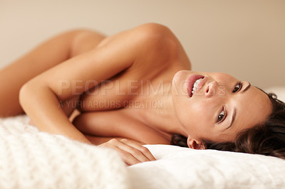 Buy stock photo Portrait of a sensual nude woman lying on a bed