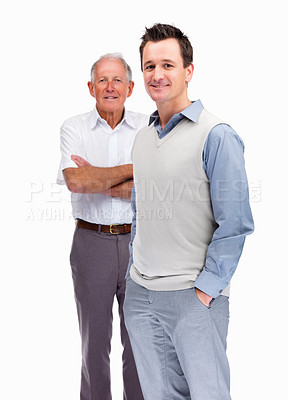 Buy stock photo Portrait of a relaxed son standing with his father behind against white background