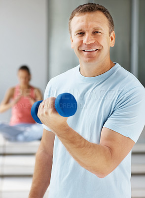 Buy stock photo Handsome and fit middle aged man working out at the gym