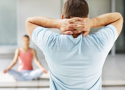 Buy stock photo Rear view of a man exercising at the gym with hands behind head