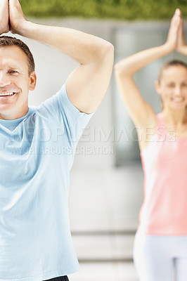 Buy stock photo Portrait of a smiling mature man practicing yoga with a woman at the back
